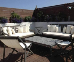 terrace decorated to white sofa sets